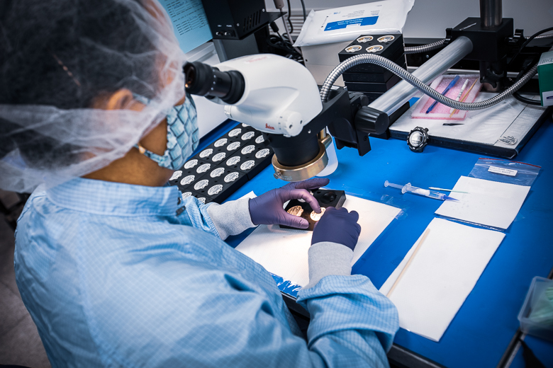 Inside a clean room at Intricon, a global leader in micromedical technology and joint development manufacturer
